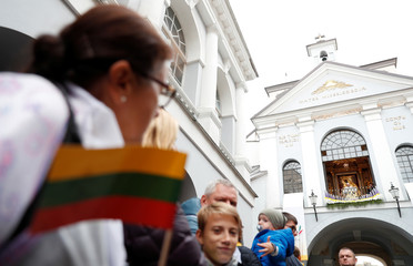Faithful listen as Pope Francis speaks at the Gate of Dawn shrine in Vilnius
