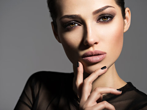 Face of a beautiful girl with smoky eyes makeup