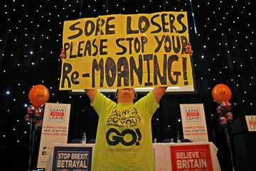 A pro-Brexit supporter holds up a banner at a 'Leave Means Leave' rally at the University of Bolton, in Bolton