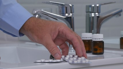 Suffering Person in Bathroom Taking Pills and Drugs