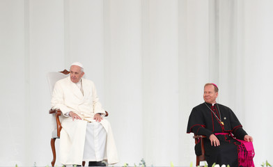 Pope Francis looks on as he arrives to meet the youth outside the Vilnius Cathedral in Vilnius