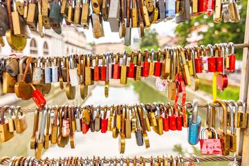 Bridge in Ljubljana city, with locks as symbol of love. Romantic tradition in Slovenia capital.