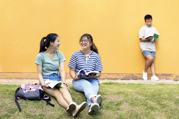 High school students; Group of happy teen Asian high school students outdoors; Group of cheerful young happy after the homework finish.