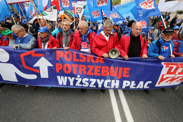 People take part in an anti-government demonstration of public-sector trade unions demanding higher wages in Warsaw