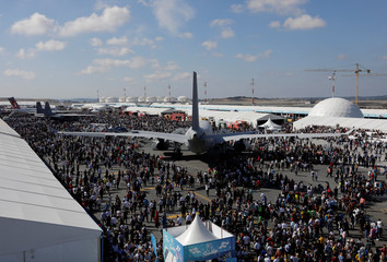 People visit Teknofest airshow at a new airport under construction in Istanbul