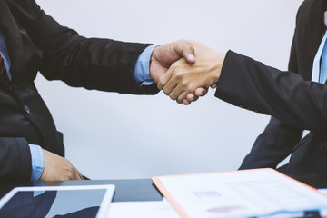 Businessman handshake. Business executives to congratulate the joint