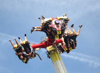 Visitors experience a thrill ride during the opening day of the 185th Oktoberfest in Munich