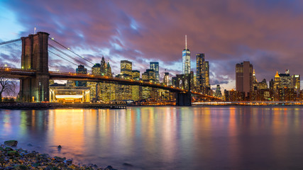 Fototapete - Brooklyn bridge and Manhattan after sunset, New York City