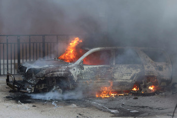 A car burns at the scene of an explosion in Mogadishu