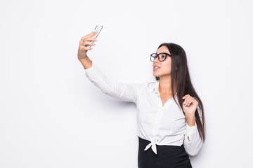 Closeup of beautiful playful business woman in eyesglasses making selfie photo on white background
