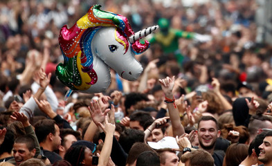 People participate in the 20th edition of the Techno Parade music event in Paris