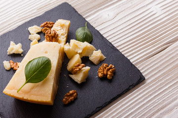 fragrant Parmesan on a slate stone slicing board