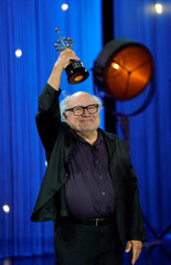 U.S. actor Danny DeVito holds up his Donostia Award for Lifetime Achievement at the San Sebastian Film Festival