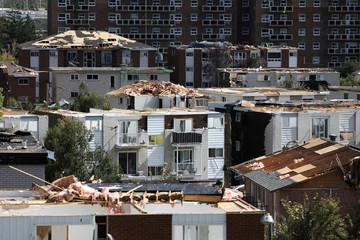 Damaged buildings are seen after a tornado hit the Mont-Bleu neighbourhood in Gatineau