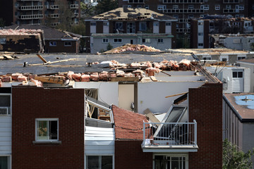 Damaged buildings are seen after a tornado hit the Mont-Bleu neighbourhood in Gatineau