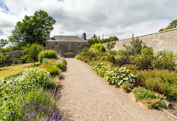 Herbaceous border in country walled garden