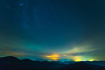 The cloud stream above mountains with stars