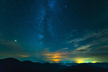 The beautiful mountain landscape on the starry sky background