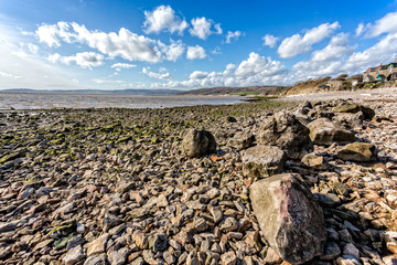 Rocky foreshore with Morecambe Bay in the background