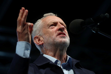 Britain's Labour Party Leader Jeremy Corbyn speaks during a rally ahead of his party's annual conference, in Liverpool.