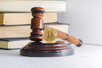 judge's hammer and bitcoin gold coin. Digital currency.