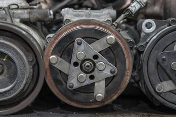 bunch of old car parts, generators