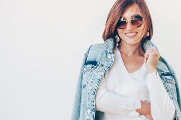 Wall Mural - Happy smiling elegant woman in denim jacket