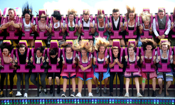 Visitors ride a roller coaster during the opening day of the 185th Oktoberfest in Munich