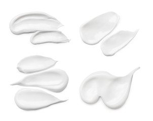 Set with different cosmetic smears on white background