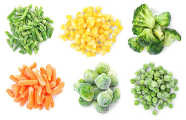 Set with frozen vegetables on white background, top view