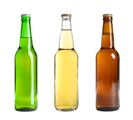 Set with different beer bottles on white background