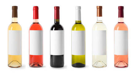Set with different blank wine bottles on white background. Mock up for design
