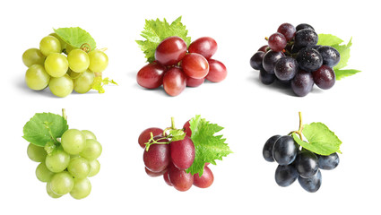 Fototapeta Set with different ripe grapes on white background