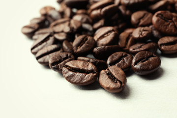Roasted coffee beans on white background, closeup
