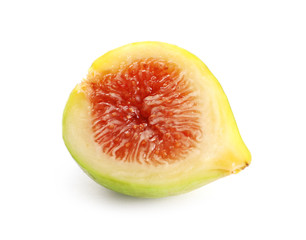 Half of ripe green fig on white background