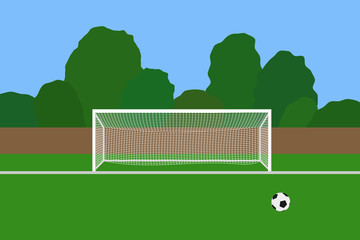 Soccer goal and ball on football stadium. Association football goal posts with net standing on a outdoor sports field