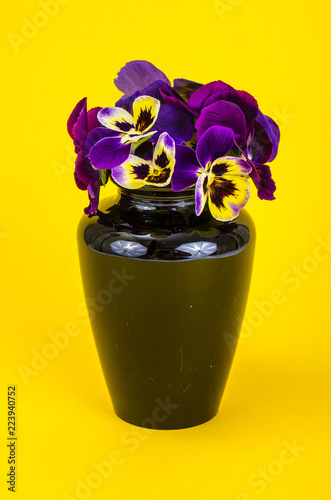 Small Vase With Bouquet Of Flowers On Bright Background Stock Photo