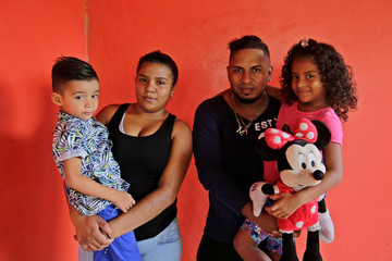Mariana Ponce, a deportee from the U.S. who was separated from her father Jesus, under the Trump administration's hardline immigration policy, poses for a photo with her brother Edison, her mother Ana Zuniga and her father Jesus in La Ceiba