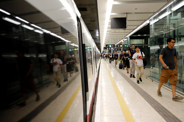 Passengers walk inside West Kowloon Terminus on the first day of service of the Hong Kong Section of the Guangzhou-Shenzhen-Hong Kong Express Rail Link, in Hong Kong