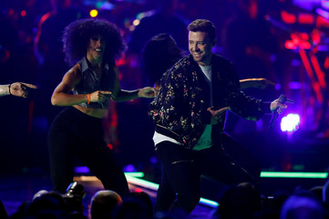 Justin Timberlake (R) performs with dancers during the iHeartRadio Music Festival at T-Mobile Arena in Las Vegas