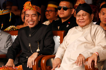 Indonesian President Joko Widodo and his challenger Prabowo Subianto attend a ceremony marking the start of the campaigning period for next year's presidential election in Jakarta