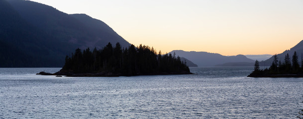Panoramic landscape view of a beautiful Pacific Ocean Inlet during a vibrant summer sunset. Taken near Port Alice, Northern Vancouver Island, BC, Canada.