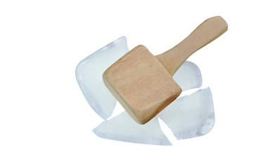 big and heavy wooden hammer smashed ice brick on white background
