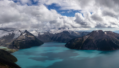 Beautiful panoramic landscape view of Garibaldi Lake vibrant sunny summer day. Taken from top of Panorama Ridge, located near Whister and Squamish, North of Vancouver, BC, Canada.