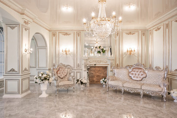 daylight in the interior and light of electric lamps. Morning in luxurious light interior in mansion .