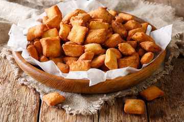 Chin chin is a fried snack in West Africa, mostly in Nigeria served in a plate on a close-up. horizontal