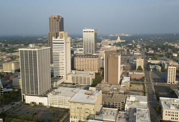 A Square aerial composition of downtown Little Rock buildings with the State Capitol Building background