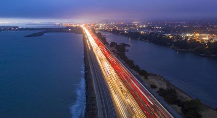 Car Streak Down A San Francisco Bay Coastal California Highway at Dusk
