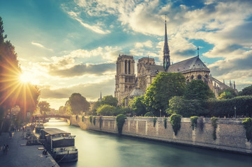Notre Dame de Paris, France, and the Seine river at sunset. Scenic travel background.