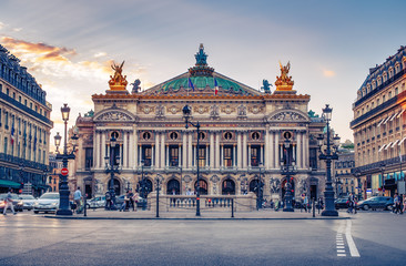 French Opera in Paris, France.  Scenic skyline against sunset sky. Travel background. Fototapete